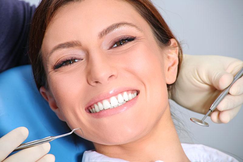 Dentist Performing Cosmetic Dentistry Procedure on a Women in Weyburn, Sk