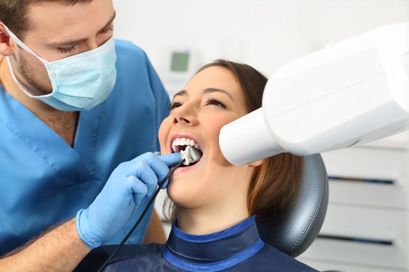 Dentist Performing Emergency Dental Care Procedure In Weyburn, SK