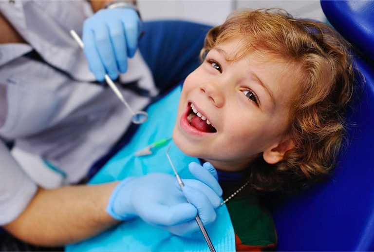 Child Having Dental Check Up from a Family Dentistry in Weyburn, SK